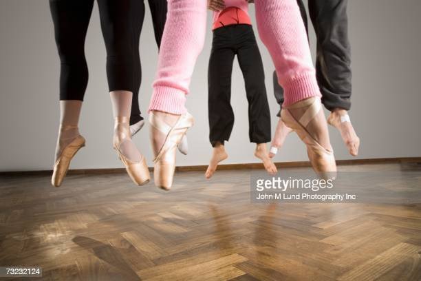 Close up of ballet dancer's feet in mid-air