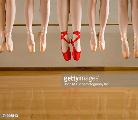 Close up of ballet dancers jumping