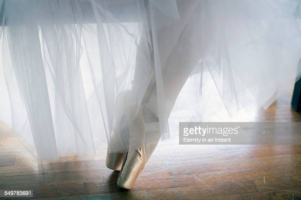 Close up of ballet shoes and dress