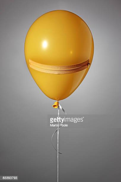 close up of balloon with a zip as a mouth