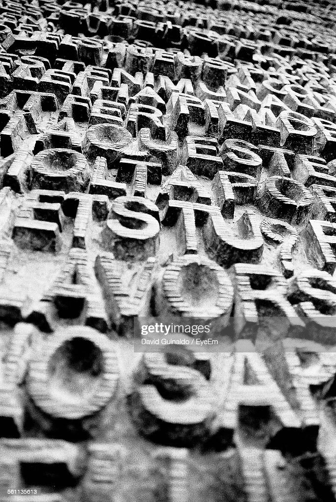 Close Up Of Bas Relief With Letters