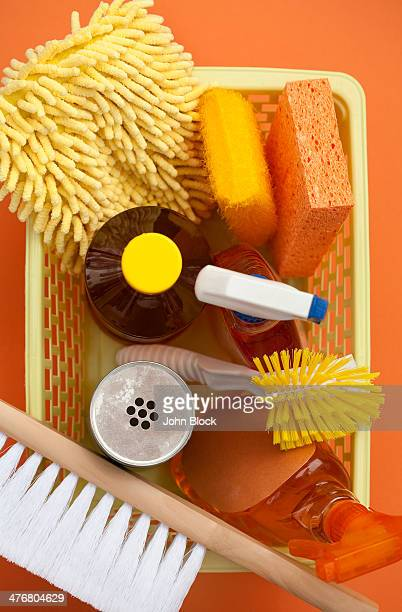 Close up of basket of cleaning supplies