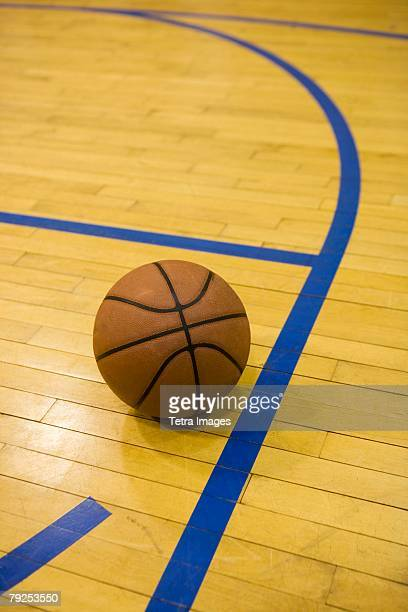 Close up of basketball on basketball court