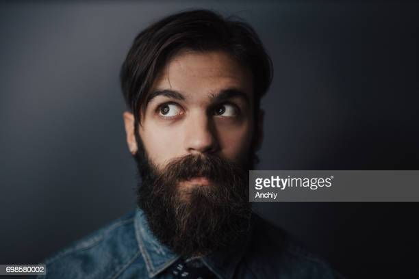 Close up of bearded man looking up