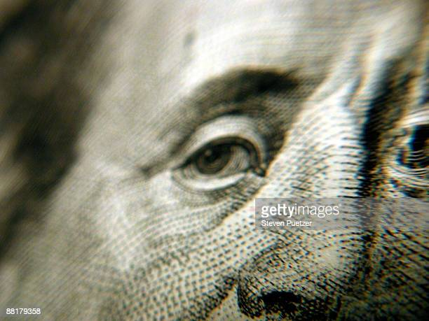 Close up of Benjamin Franklin's eyes and nose on currency