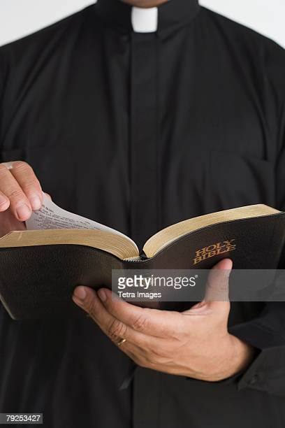 Close up of bible in priest?s hands