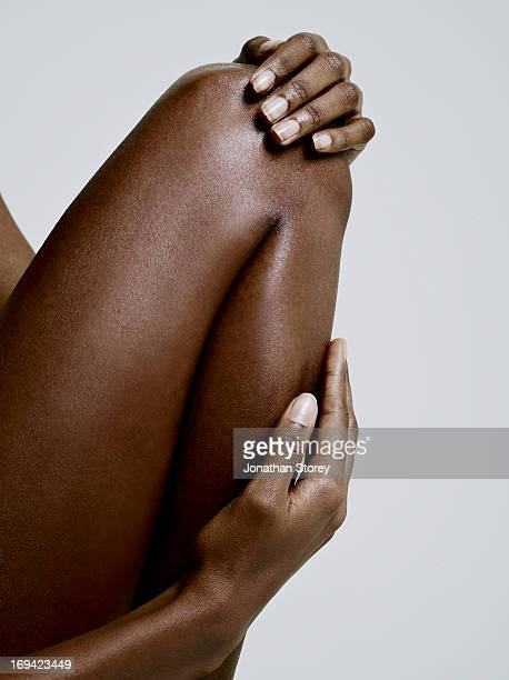Close up of black females bent knee