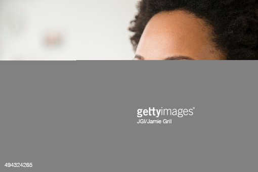 Close up of Black woman smiling with fingers crossed