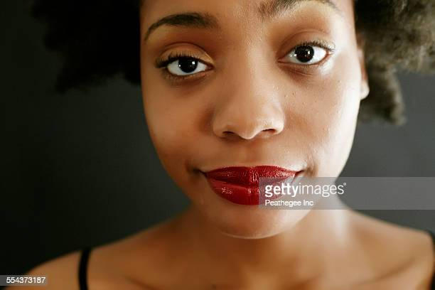 Close up of black woman smirking