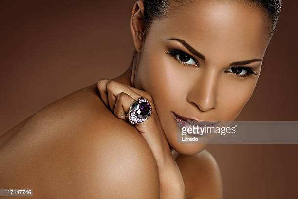 close up of black woman wearing ring