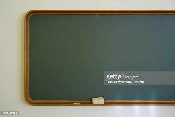 Close Up Of Blackboard Mounted On Wall
