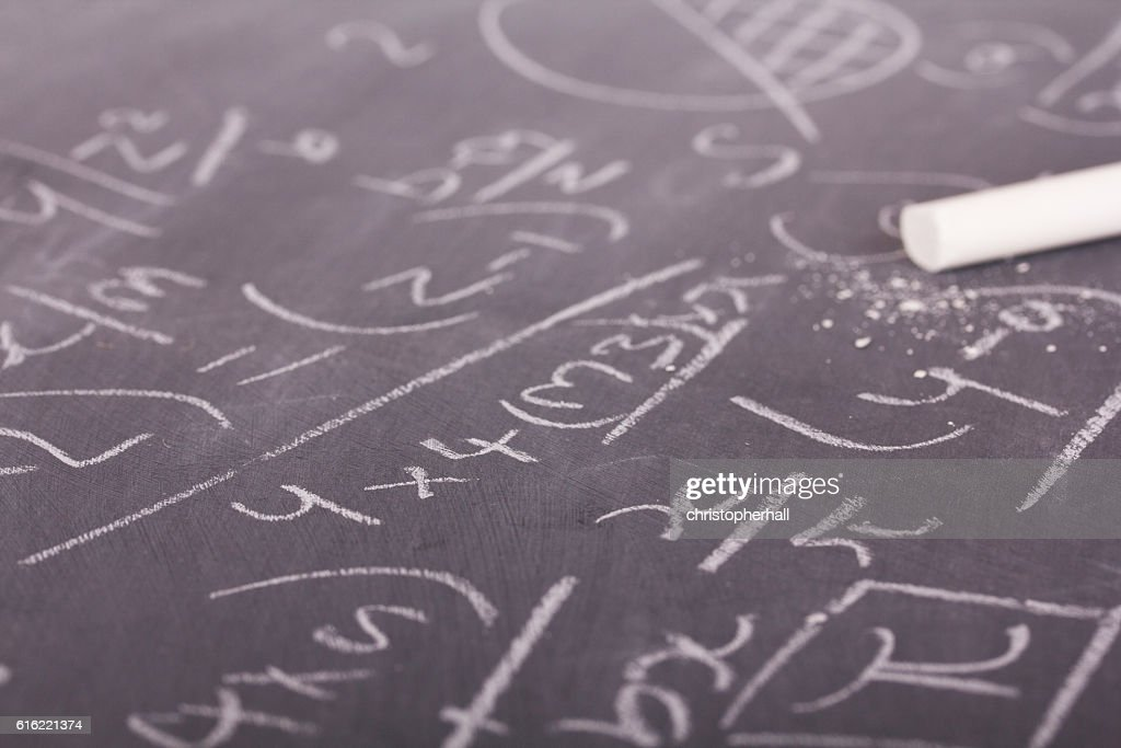 Close up of blackboard with maths equations : Stock Photo