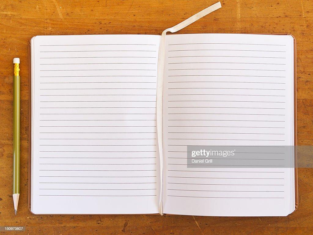 Close up of blank, open notebook, studio shot