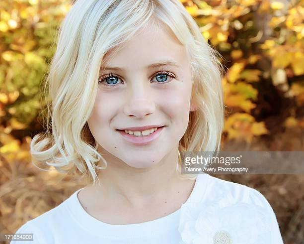 Close up of blond girl with big blue eyes