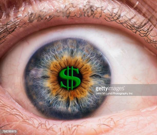 Close up of blue and brown eye watching money