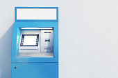 Close up of a blue ATM machine standing near a concrete wall. Concept of monetary operations. 3d rendering. Mock up