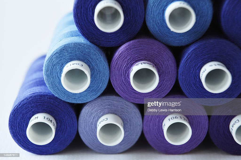 Close up of blue spools of thread : Stock Photo