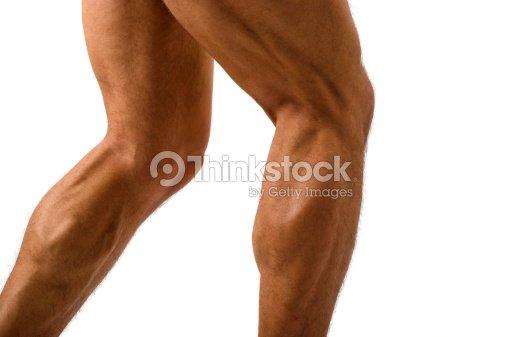 Close Up Of Bodybuilder Muscular Legs Stock Photo | Thinkstock