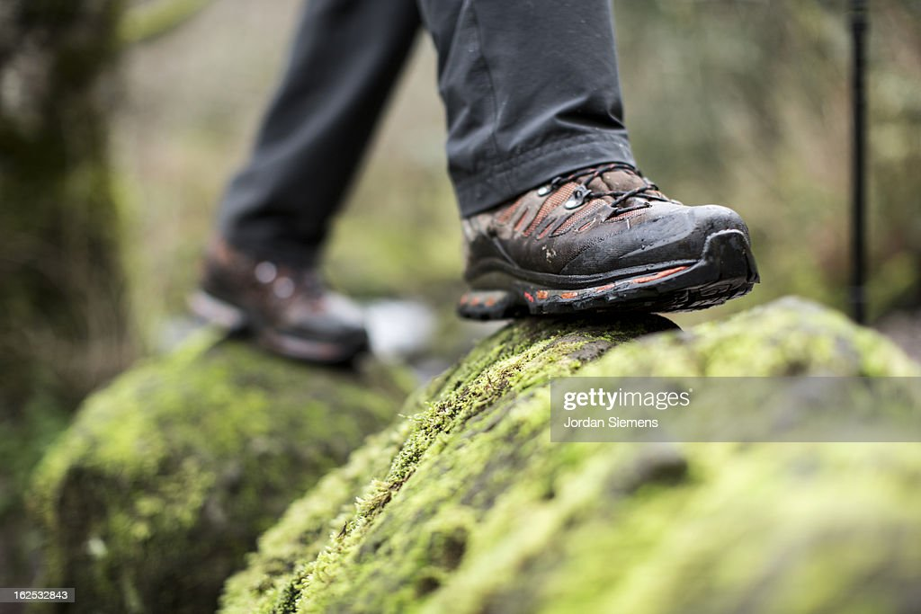 Close up of boots on a mossy rock. : Stock Photo