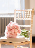 Close up of bouquet of roses on chair
