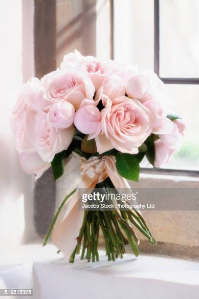 Close up of bouquet of roses on window sill
