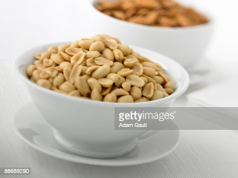 Close up of bowl full of peanuts : Stock Photo