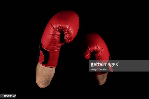 Close up of boxers' arms and gloves