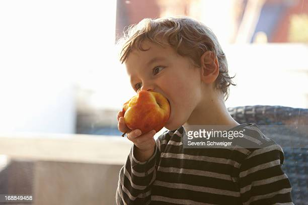 Close up of boy eating apple