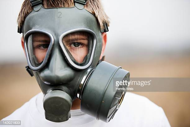 Close up of boy wearing gas mask