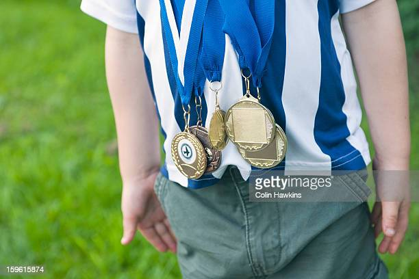 Close up of boy wearing medals