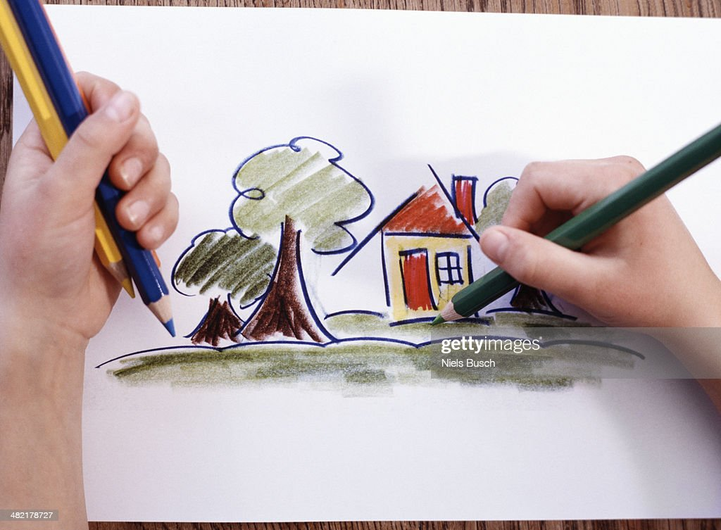 Close up of boys hands coloring a picture drawing