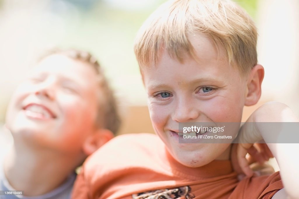Close up of boys smiling face outdoors : Stock Photo