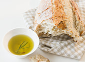 Close up of bread and olive oil on table