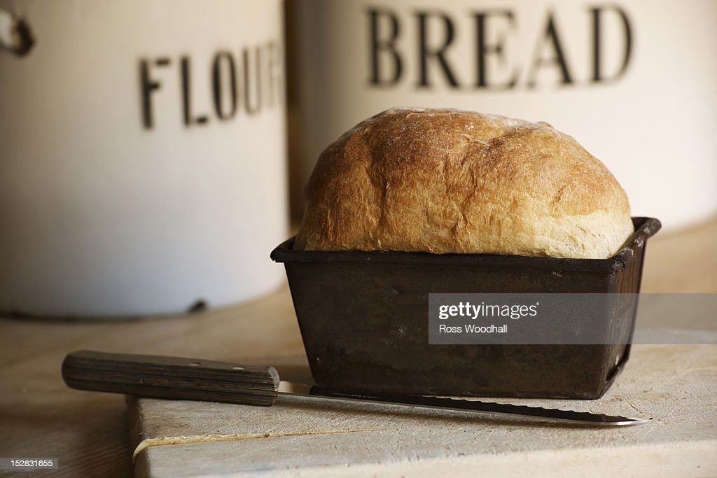 Close up of bread in loaf tin : Stock Photo