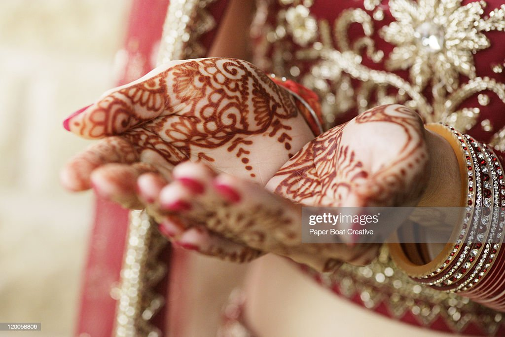 Close up of bridal hands with henna tattoo design : Stock Photo