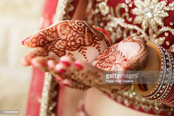 Close up of bridal hands with henna tattoo design