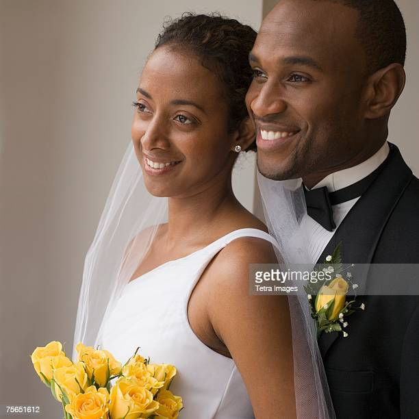 Close up of bride and groom smiling