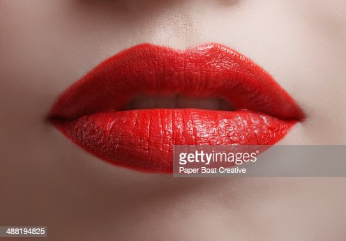 Close up of bright red shiny lips