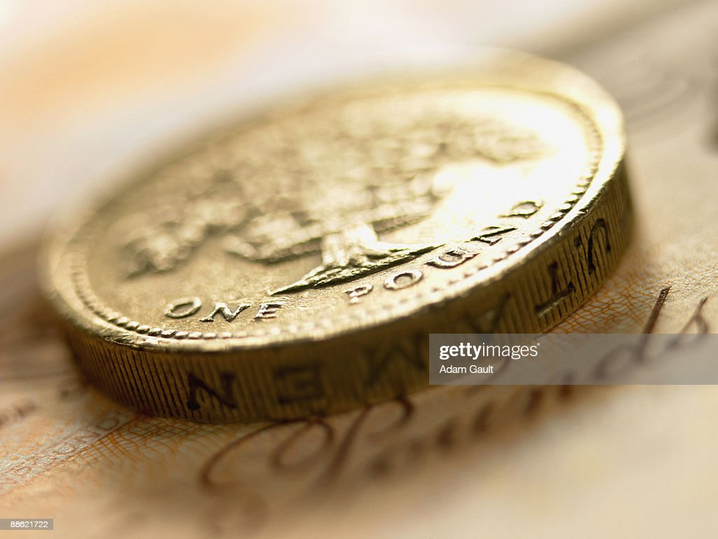 Close up of British pound coin and currency : Stock Photo