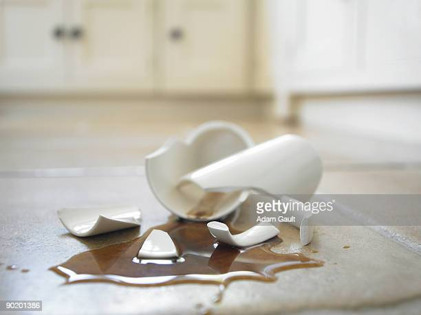 Close up of broken coffee mug and spilled coffee