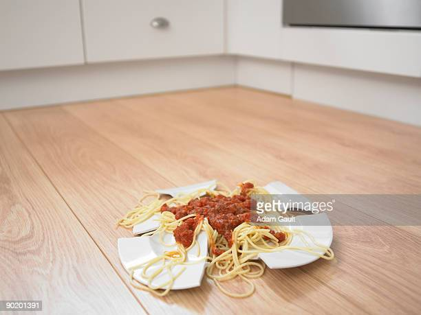 Close up of broken plate of spaghetti