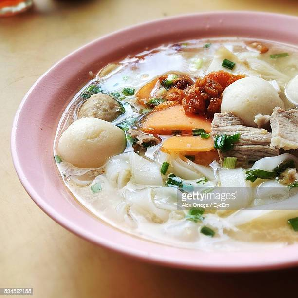 Close Up Of Broth With Dumplings