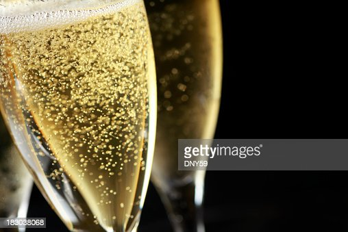 Close up of bubbles in freshly poured Champagne glass