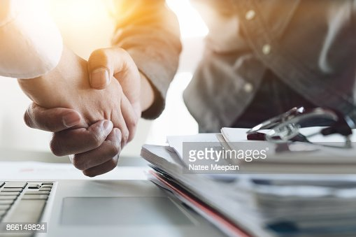 Close up of Business people shaking hands, finishing up meeting, business etiquette, congratulation, merger and acquisition concept : Stock Photo