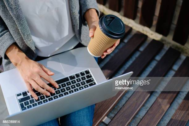 Close up of business woman working outdoors