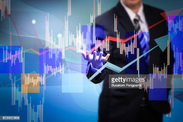 Close up of businessman hand presenting digital charts