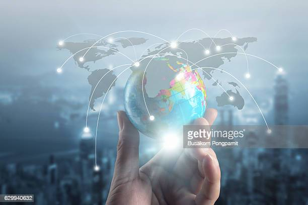 Close up of businessman hand showing texture the world with digital social media network