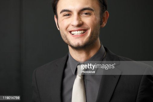 Close up of businessman smiling : Stock Photo