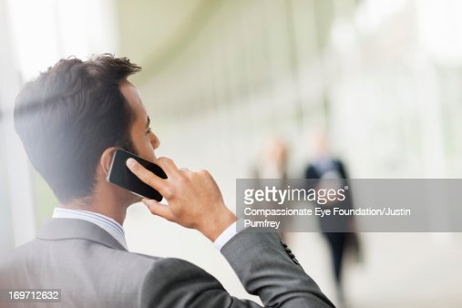 Close up of businessman using mobile phone : Stock Photo