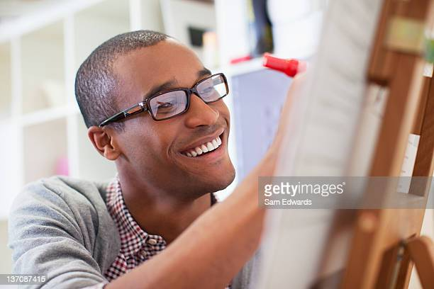 Close up of businessman writing on chart